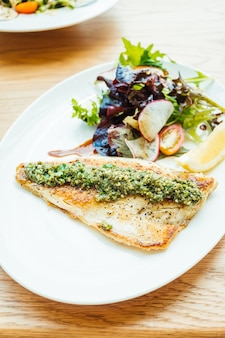 Grilled sea bass fish meat steak with vegetable