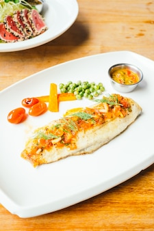 Grilled sea bass fish meat with sauce