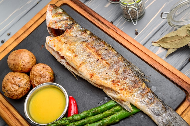 Grilled sea bass fish with potatoesnd vegetables