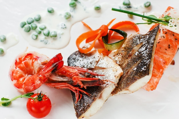 Grilled seafood mix on white plate