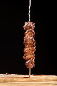 Grilled shish kebab meat on skewers