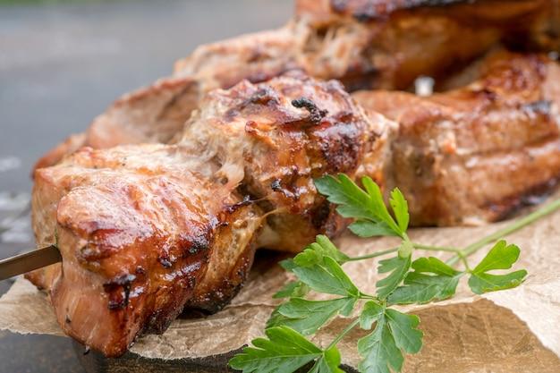 Grilled shish kebab or shashlik on skewers closeup