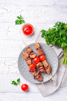 Grilled shish kebab skewers with tomatoes
