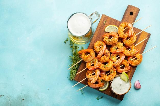 Grilled shrimp skewers or langoustines.