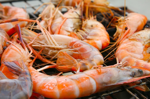 Grilled shrimps on the flaming grill.