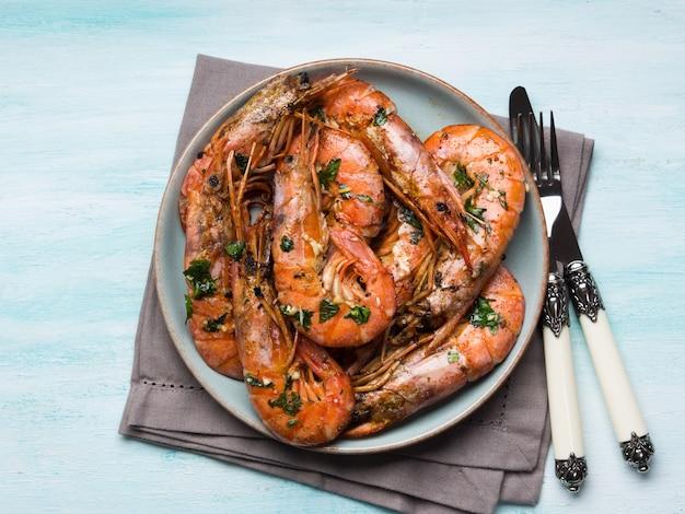 Grilled shrimps on pastel background