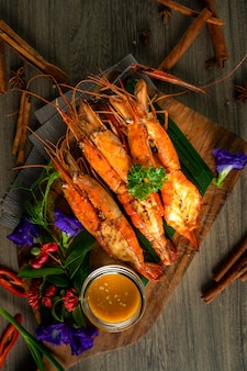 Grilled shrimps on the wooden board.