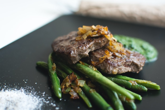 Grilled sirloin steak with bean pods