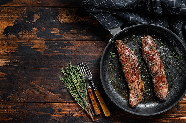 Grilled skirt machete steak in a pan