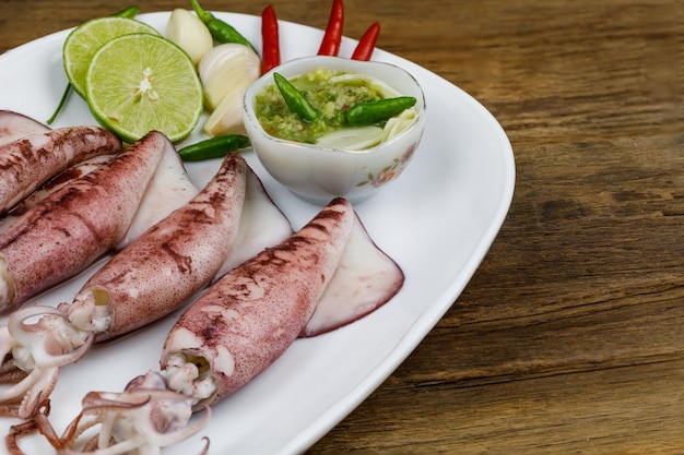 Grilled squid in a white dish with sauce