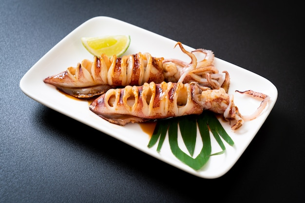 Grilled squid with teriyaki sauce on plate
