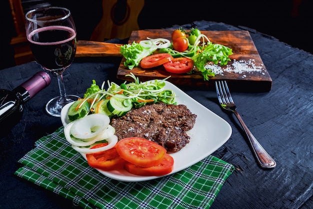 Grilled steak and red wine on the table