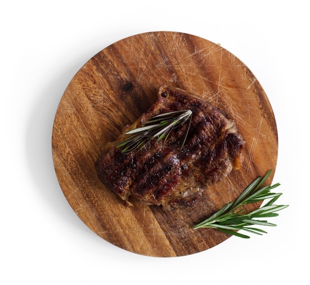 Grilled steak on table