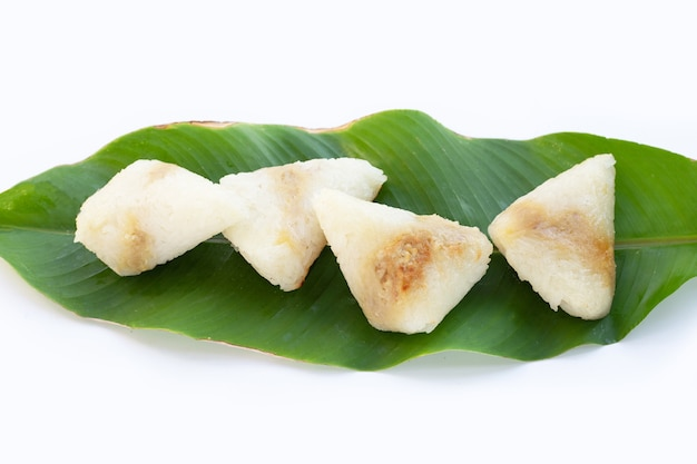 Grilled sticky rice in banana leave with mung beans filling