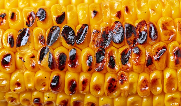 Grilled sweet corn macro background, top view
