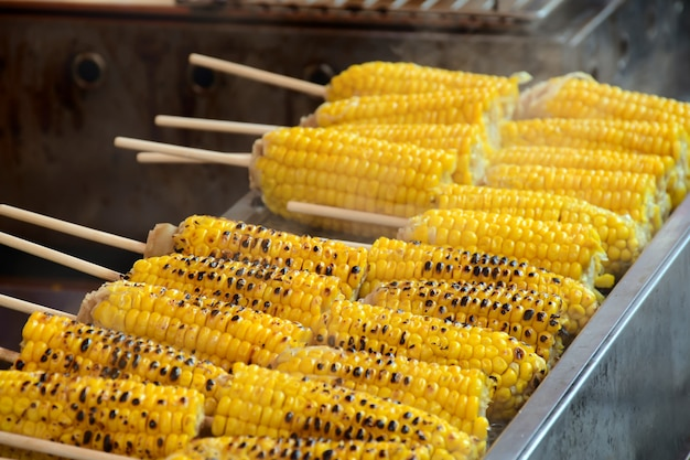 Grilled sweet corn in street food style.