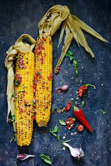 Grilled sweet corn with tomato salsa, cilantro, basil, chili pepper and garlic