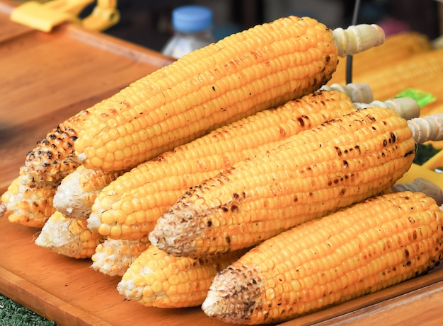 Grilled sweet organic corns for sale.