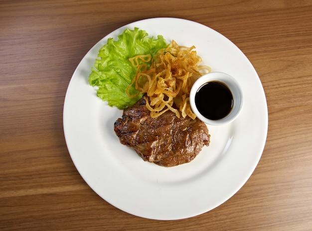 Grilled t-bone  beef steak and vegetables