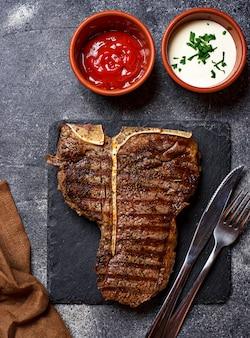 Grilled t-bone steak on dark