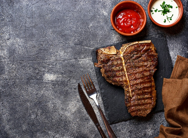 Grilled t-bone steak on dark