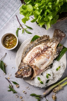 Grilled tilapia with salt and seafood sauce