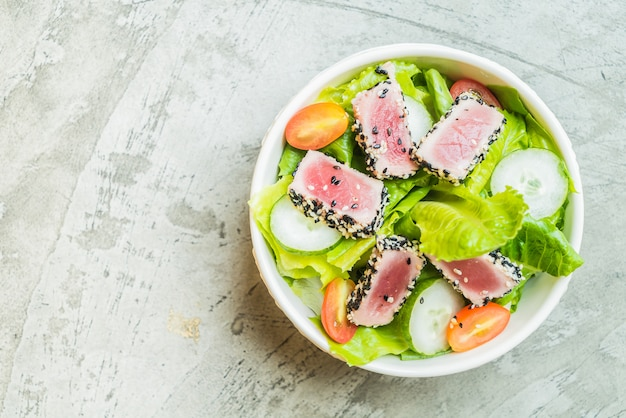 Grilled tuna salad in white bowl - healthy food
