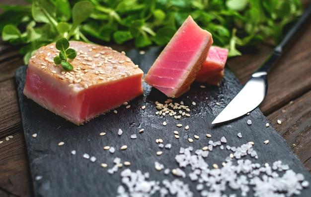 Grilled tuna steak green salad close up