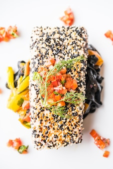Grilled tuna steak with pasta and vegetable