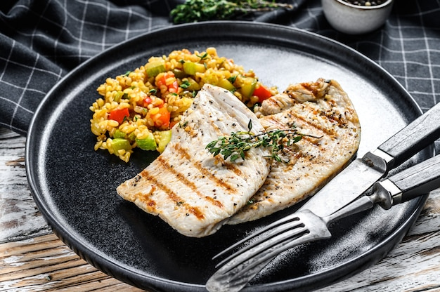 Grilled turkey breast steaks with quinoa salad