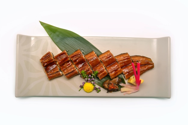 Grilled unagi eel with soy based sauce on plate in japanese styl