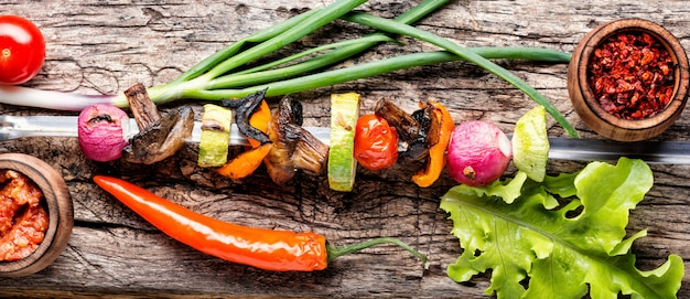 Grilled vegetable shish kebab with peppers, mushrooms, and onions