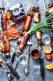Grilled vegetables, meat and sausage