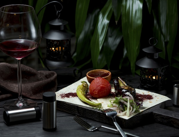 Grilled vegetables served with lavash and species