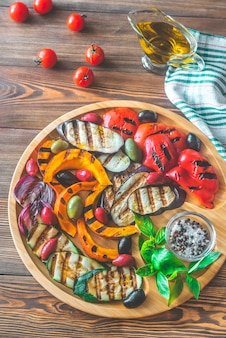 Grilled vegetables on wooden tray