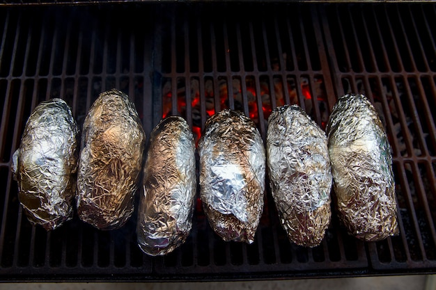 Grilled whole potatoes with foil