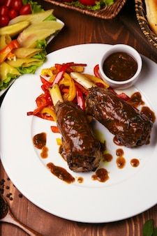 Grilled with teriyaki sauce beef lamb with grilled bell pepper in white plate.