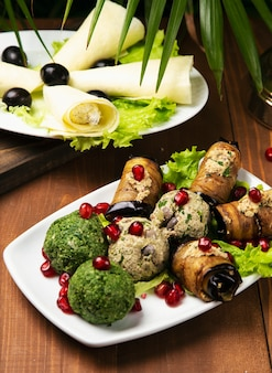 Grilled zucchini, eggplant, broccoli rolls stuffed with cream cheese, pickles, capers and herbs, pomegranate seeds