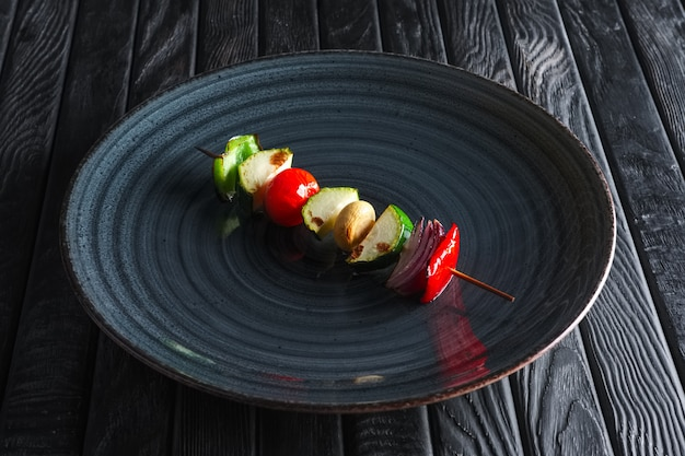 Grilled zuccini, bell pepper, mushroom, tomato and onion on skewer