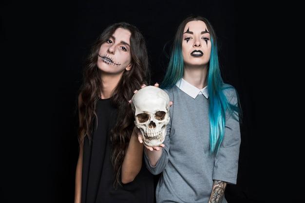 Grim girls holdings skull