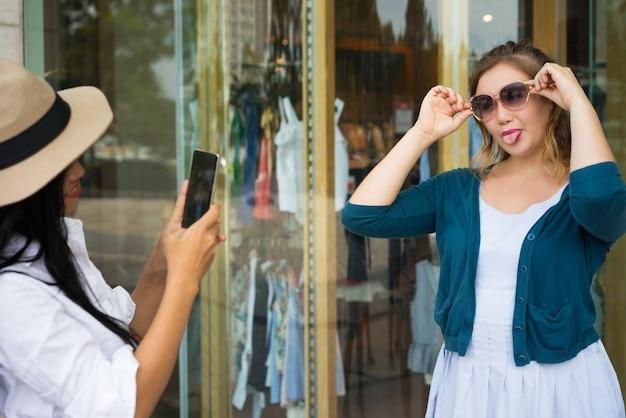 Grimacing funny girl posing for photo