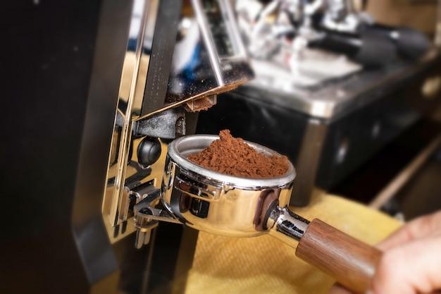 Grinding coffee on grinder machine
