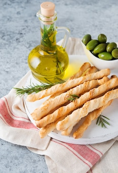 Grissini breadsticks with sesame seeds - traditional italian snack, selective focus, vertical orientation