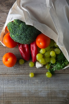 Groceries in eco bag with fruits and vegetables. zero waste food shopping tote.