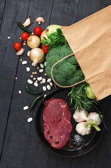 Grocery bag top view with healthy food on a wooden top view