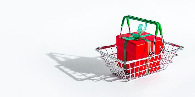 Grocery basket with red gift box on white