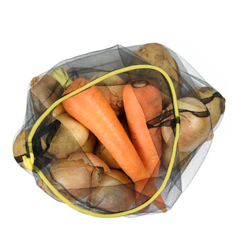 Grocery eco bag with potatoes and carrots on white
