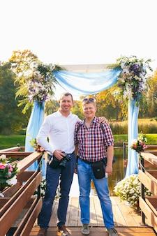 Grodno, belarus - oct 02: two photographers on wedding ceremony posing during workshop in manor-park complex on october 02, 2016 in radzivilki, belarus