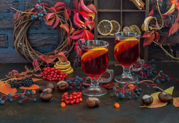 Grog, mulled wine, punch, hot tea with orange