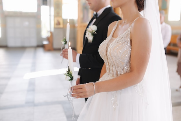 Groom and bride in church on wedding ceremony.